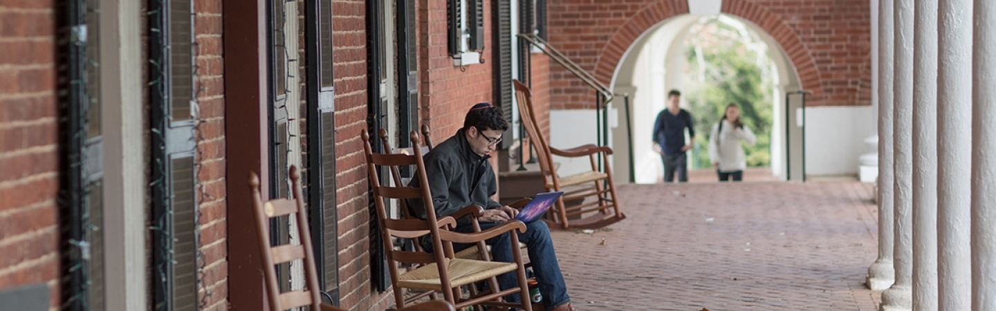 Student studying in the halls of the lawn